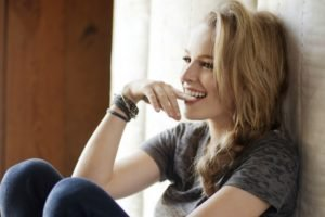women, Blonde, Bridgit Mendler, Smiling, Open mouth, Biting, Bracelets, T shirt, Jeans, Biting finger, Braids