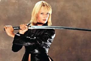 women, Blonde, Actress, Uma Thurman, Blue eyes, Katana, Kill Bill, Leather jackets, Simple background