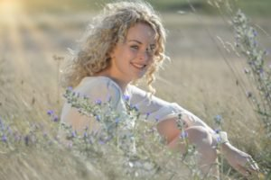 women, Model, Blonde, Long hair, Smiling, Women outdoors, Blouses, Curly hair, Field, Sitting, Face, Plants, Sunlight