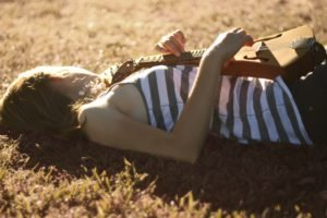 women, Lying down, Musical instrument, Striped clothing, Sunlight