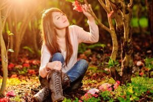 women, Model, Brunette, Long hair, Nature, Trees, Forest, Closed eyes, Women outdoors, Sitting, Asian, Smiling, Flowers, Sunlight, Boots, Jeans