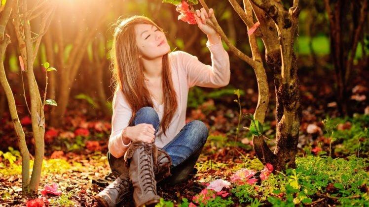 women, Model, Brunette, Long hair, Nature, Trees, Forest, Closed eyes, Women outdoors, Sitting, Asian, Smiling, Flowers, Sunlight, Boots, Jeans HD Wallpaper Desktop Background