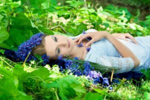 women, Model, Brunette, Face, Women outdoors, Lying on back, Nature, Flowers, Leaves, Makeup, Dress, Sunlight, Blue flowers