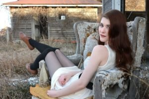 women, Model, Brunette, Women outdoors, Looking at viewer, Knee highs, Blue eyes, Abandoned, Straw, Old building, Stockings, Belt, Chair, Sitting