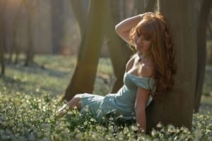 women, Model, Redhead, Long hair, Nature, Trees, Forest, Women outdoors, Sitting, Dress, Looking at viewer, Freckles, Flowers, Sunlight, Smiling