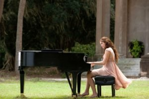 women, Long hair, Dress, Trees, Women outdoors, Barefoot, Sitting, Chair, Looking down, Piano, Playing, Musicians, Field, Grass, Stairs, Building, Miley Cyrus