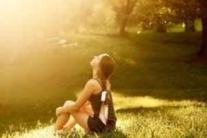 women, Model, Brunette, Long hair, Sitting, Nature, Trees, Braids, Shorts, Tank top, Sunlight, Park, Field, Grass, Looking up, Barefoot