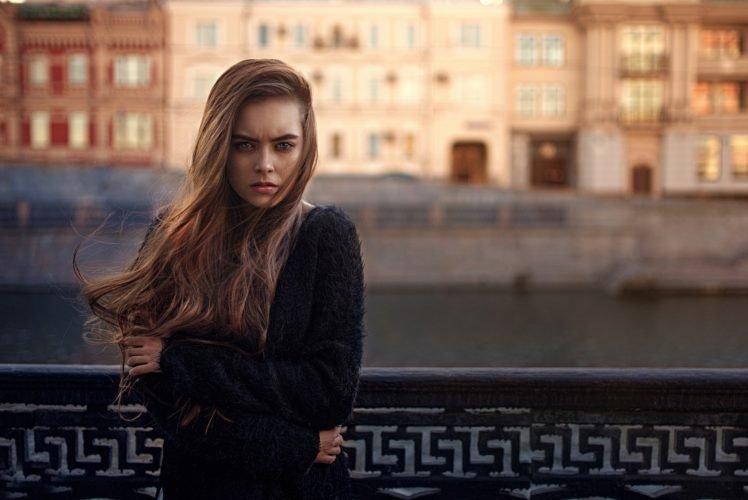 women, Model, Brunette, Long hair, Women outdoors, Urban, Looking at viewer, Blue eyes, Windy, Sweater, Building, River HD Wallpaper Desktop Background