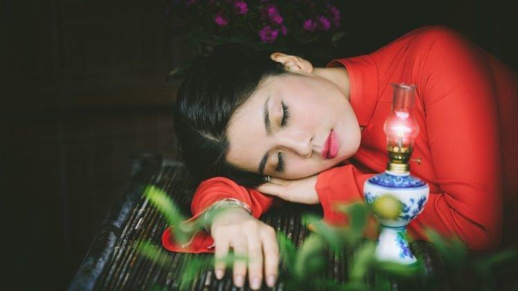 women, Model, Brunette, Long hair, Closed eyes, Sleeping, Face, Asian, Red dress, Table, Gas lamps, Leaves, Flowers HD Wallpaper Desktop Background