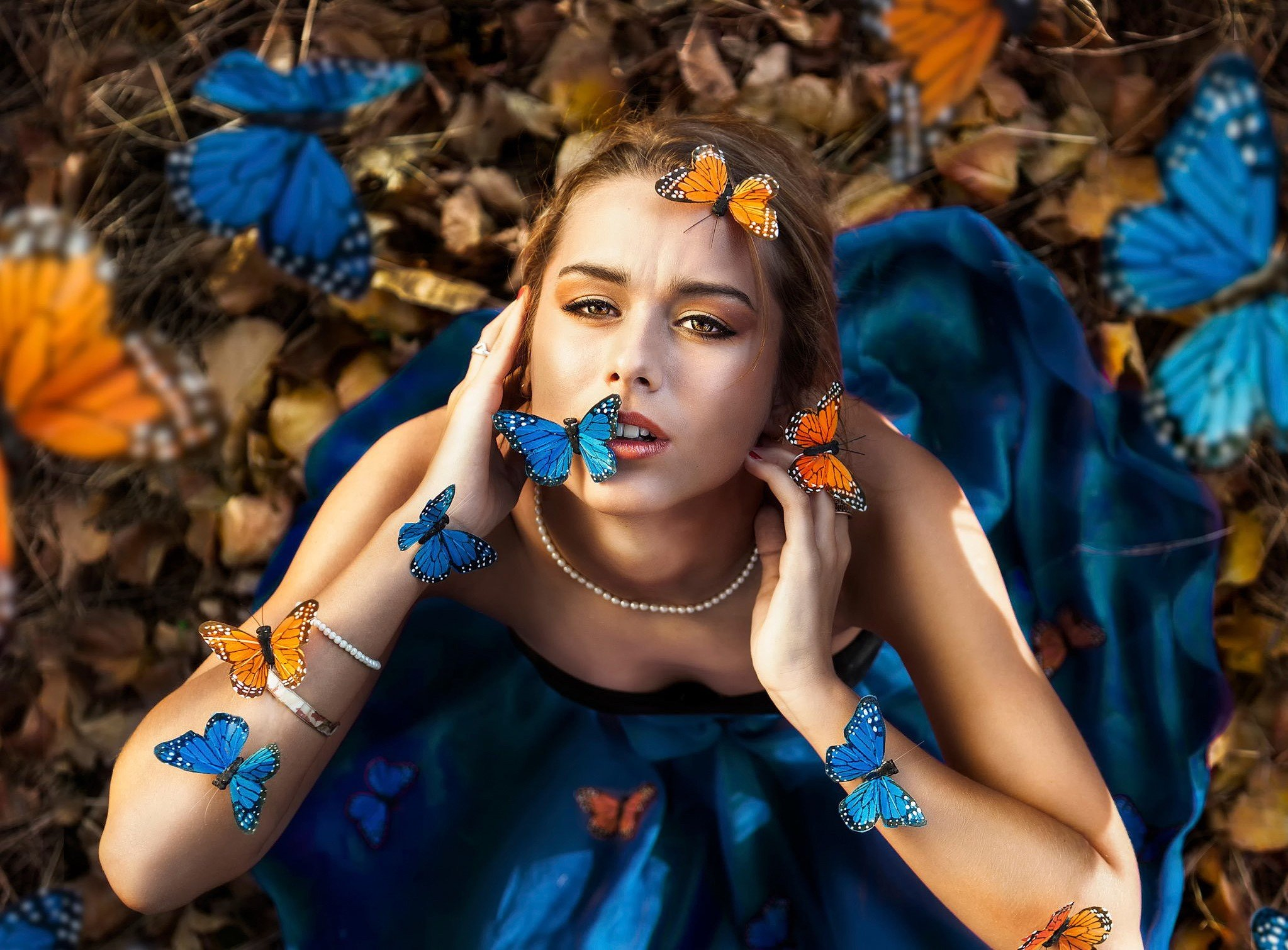 women, Model, Brunette, Long hair, Women outdoors, Nature, Looking at viewer, Blue dress, Open mouth, Butterfly, Necklace, Pearls Wallpaper