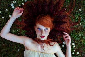 women, Blue eyes, Face, Redhead, Freckles, Lying down, Lying on back, Long hair, Flowers, Grass, Women outdoors, Red lipstick, Looking at viewer