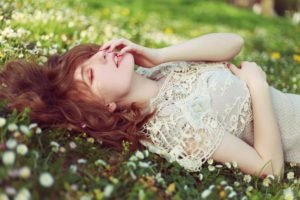 women, Lying down, Closed eyes, Auburn hair, Flowers, Grass