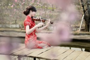 women, Model, Brunette, Long hair, Asian, Women outdoors, Violin, Playing, Sitting, Pier, Wooden surface, River, Trees, Flowers, Red dress