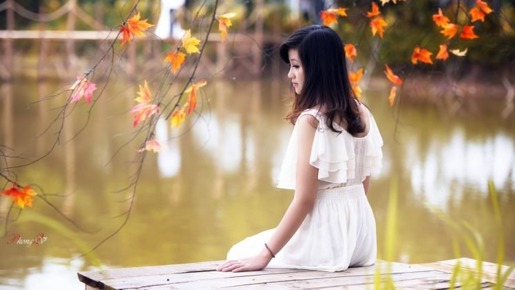 women, Model, Brunette, Long hair, Asian, Women outdoors, Nature, Trees, Looking away, White dress, Leaves, Water, Lake, Pier, Wooden surface, Sitting, Fall, Branch, Vietnamese HD Wallpaper Desktop Background