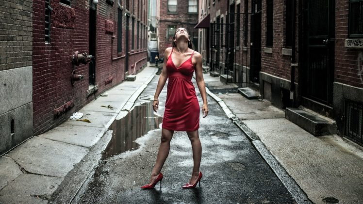 women, Model, Brunette, Long hair, Women outdoors, Red dress, Looking up, Street, Building, Bricks, Water, High heels, Stiletto, Cleavage HD Wallpaper Desktop Background
