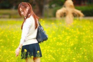 women, Model, Redhead, Long hair, Asian, Closed eyes, Women outdoors, Nature, Field, Yellow flowers, Sweater, Bag, Short skirt, Park